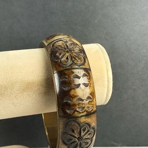 Vintage carved brown brass bangle bracelet